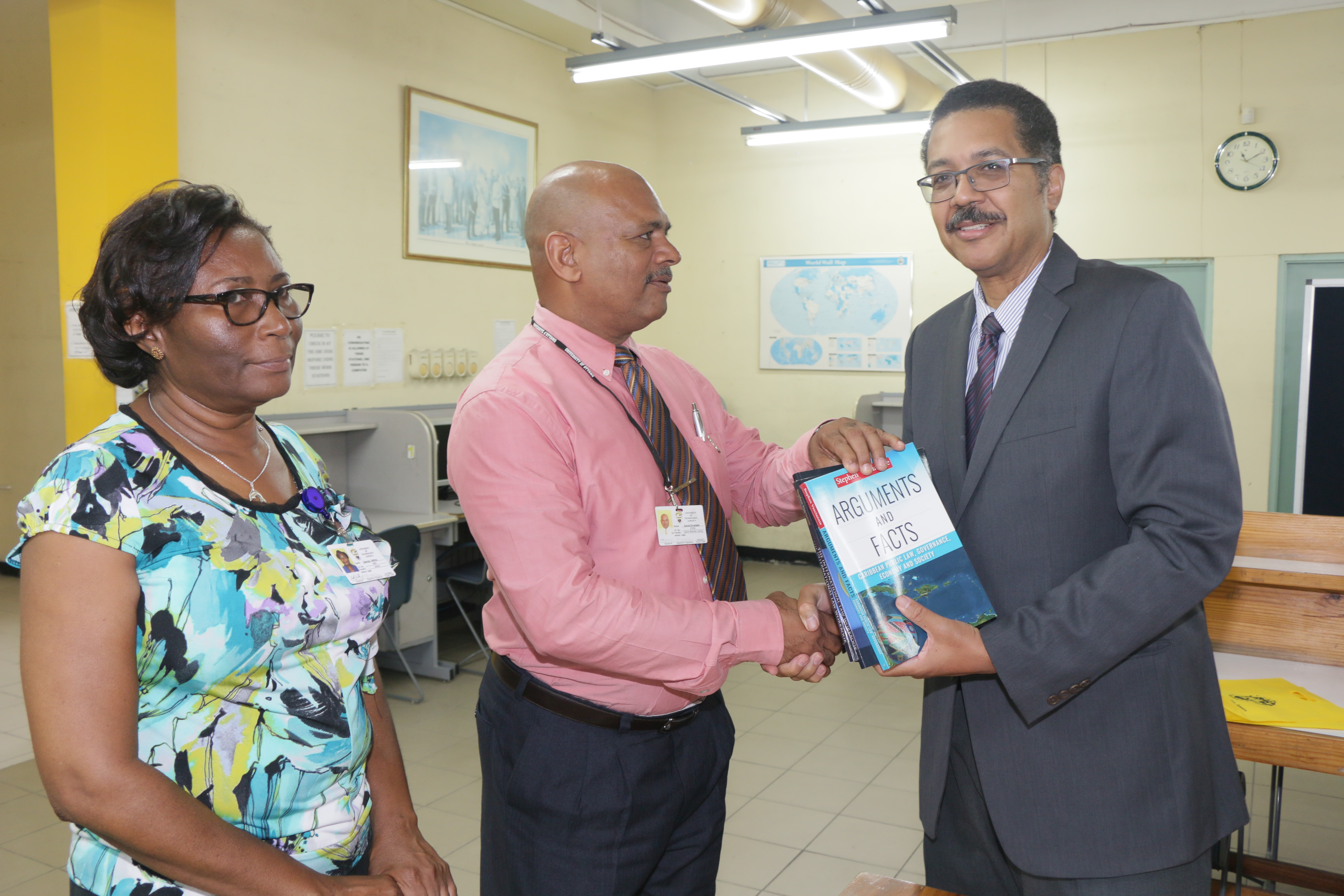 President Vasciannie Presents Collection of his Publications to Calvin McKain Library